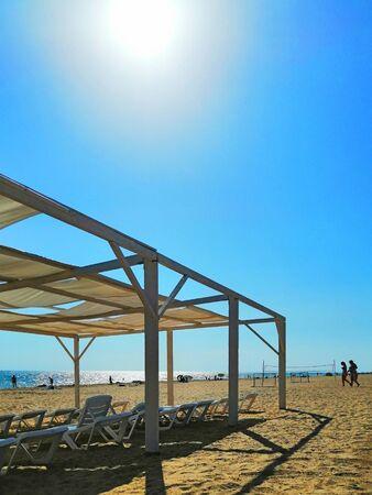 sunshade, sun beds on a sandy beach