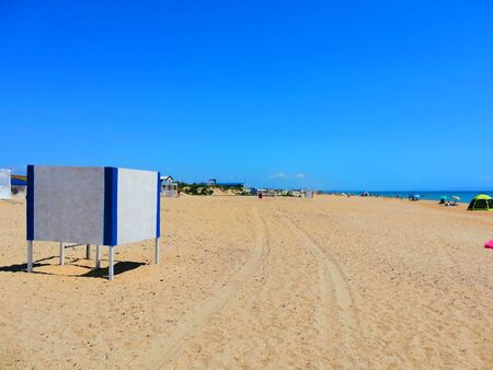 a place for changing clothes on a sandy beach, summer