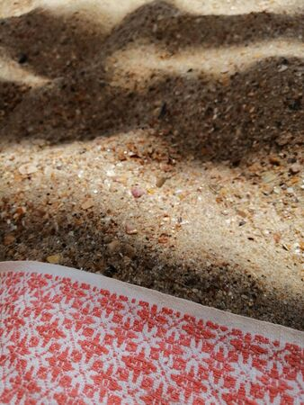 sand in the shade and a piece of cloth Banco de Imagens