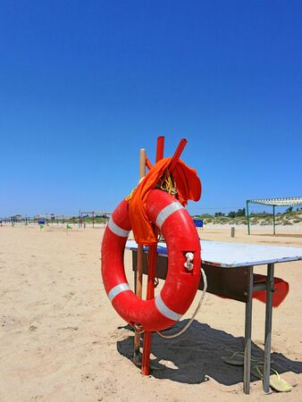 lifebuoy on a sandy beach, old table