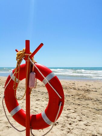 lifebuoy against the background of the sea, sand and sky Banco de Imagens