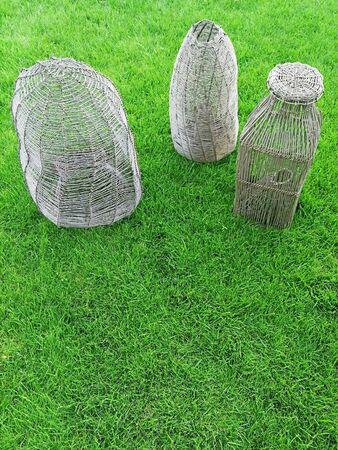 metal rod fish traps on green grass