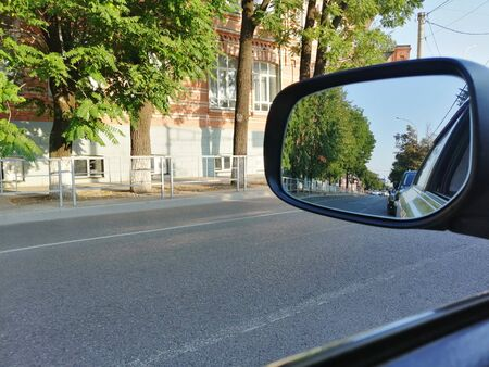 side mirror of vehicles, reflection and road Banco de Imagens