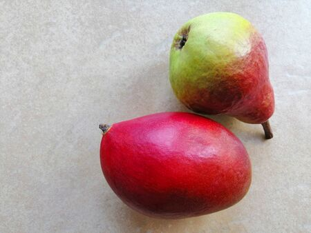 mango and pear on a light background Banco de Imagens