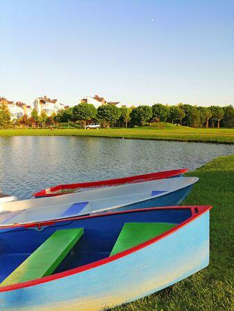 colorful boats on the lake Banco de Imagens