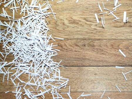 white paper shavings on a wood background