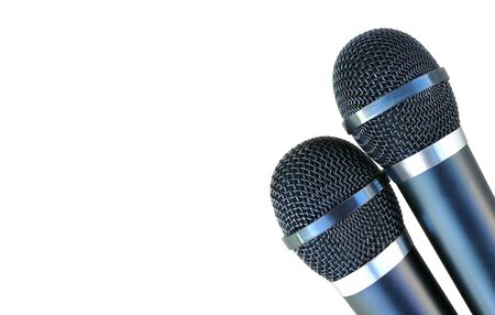two microphones for karaoke - black, wireless, metal. isolated on white background. left space for text