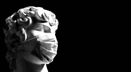 coronavirus. young man in a medical mask - place for text. sculpture in a protective mask is a contemporary art. Kovid-19 in Europe. medical mask - disease prevention
