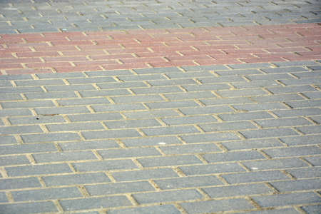 Gray paving slabs in the city limits.