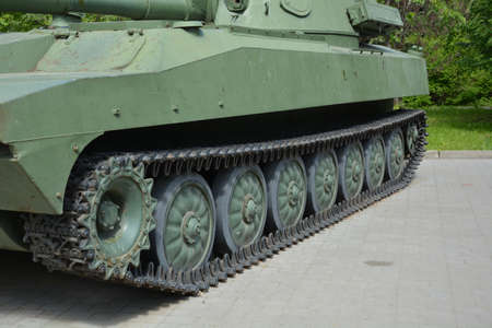 Military equipment on the eve of the Great Victory in the war. Detail of a Russian tracked self-propelled tank close-up.
