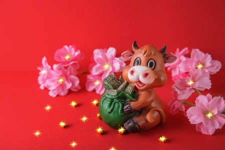 Chinese New Year 2021 decoration Ox on red background. Flowers of good fortune.