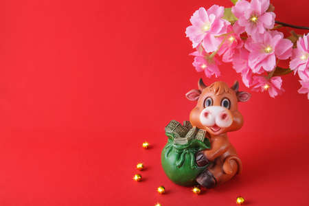 Chinese New Year 2021 decoration Ox on red background. Flowers of good fortune. copy space