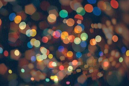 Bokeh light, shimmering blur spot lights on beige abstract background. 版權商用圖片