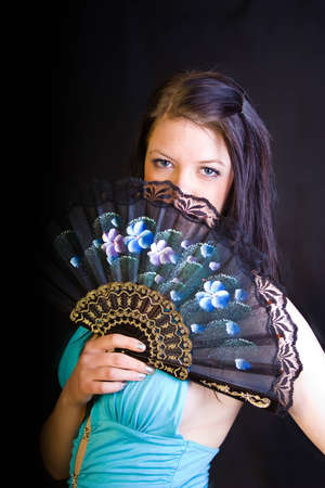 18's: A portrait of an european teenager girl holding a fan Stock Photo