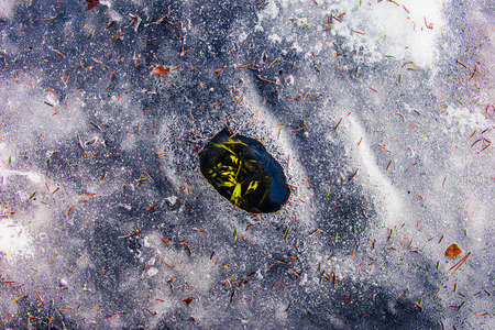frozen lake: A hole in the ice of a frozen lake Stock Photo