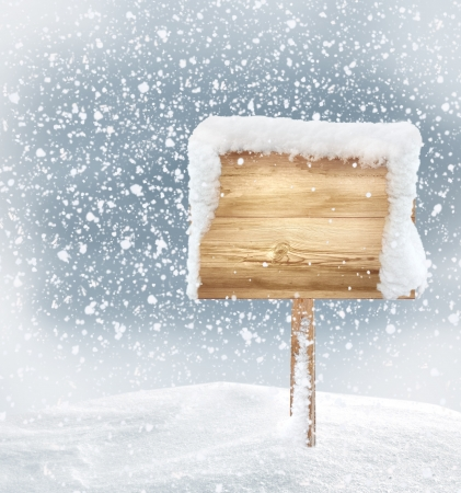 fresh snow: wooden signboard in snow