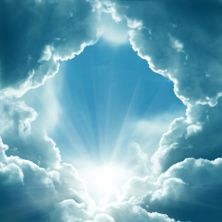 jesus in heaven: dark sky with sun Stock Photo