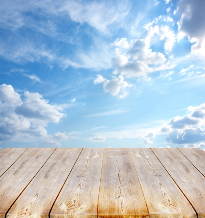 brightly:  sky background with with wooden planks