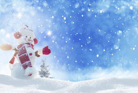Happy snowman standing in winter christmas landscape Stok Fotoğraf - 34387548