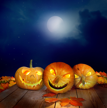 halloween scary: Scary halloween pumpkins on a wooden table