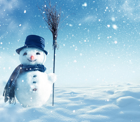 frosty the snowman: Happy snowman standing in winter christmas landscape