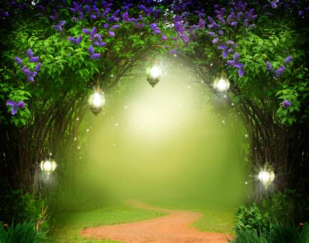 ファンタジー背景。道路と魔法の森。美しい春の風景。ライラックの木の花 写真素材