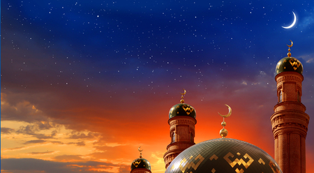 Ramadan Kareem background.Crescent moon at a top of a mosque