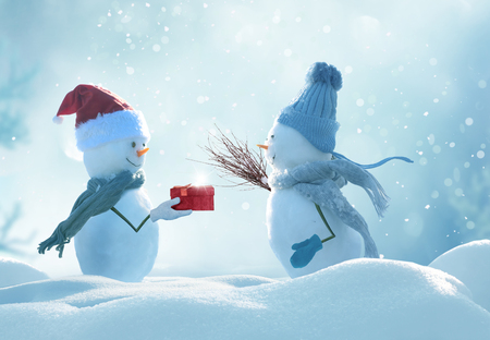 Merry christmas and happy new year greeting card .Two cheerful snowman  standing in winter christmas landscape.