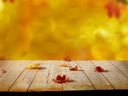 concep: Colorful maple leaves on wooden  table.Falling leaves natural background .Autumn season concep Stock Photo