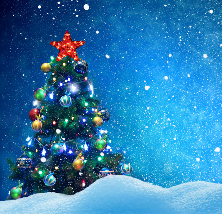 Winter background.Merry Christmas and happy New Year greeting card with copy-space.Christmas tree with  decorations