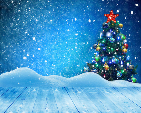 Merry Christmas and happy New Year greeting background with table .Winter landscape with snow and Christmas tree