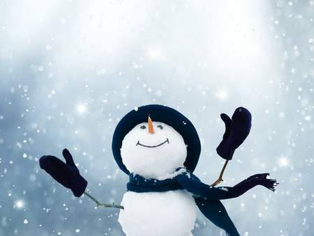Merry Christmas and happy New Year greeting card .Happy snowman standing in winter  landscape.Snow background