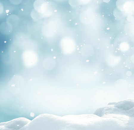 Winter background with snow and blurred bokeh.Merry Christmas and happy New Year greeting card with copy-space.