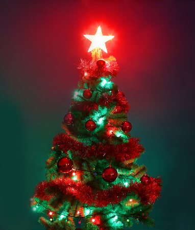 Decorated Christmas tree.Merry Christmas and happy new year greeting background with copy-space