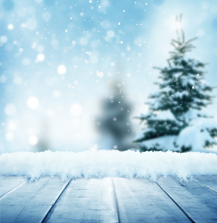 Merry christmas and happy new year greeting background with table .Winter landscape with snow and christmas trees Stock Photo - 89552641