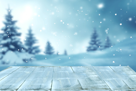 Merry christmas and happy new year greeting background with table .Winter landscape with snow and christmas trees 스톡 콘텐츠