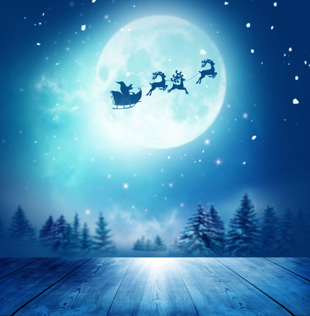 Merry christmas and happy new year greeting card with table. Santa and his sleigh flying over snowy landscape Stock Photo - 91423324
