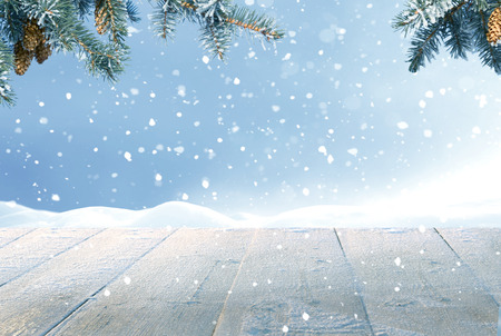 Merry Christmas and happy New Year greeting background with table .Winter landscape with snow  Stock Photo