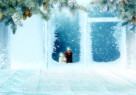 Merry Christmas and happy new year greeting background with frosted window with Christmas decoration .Winter landscape with snow and Christmas trees