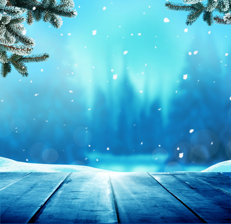 Merry Christmas and happy New Year greeting background with table .Winter landscape with snow  스톡 콘텐츠