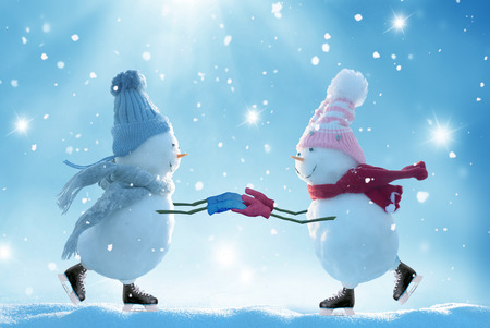 Merry christmas and happy new year greeting card .Two ice skating  snowmen