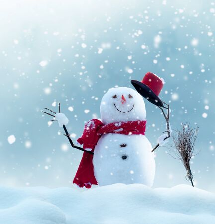 Merry christmas and happy new year greeting card with copy-space.Happy snowman standing in winter christmas landscape.Snow background Stock Photo
