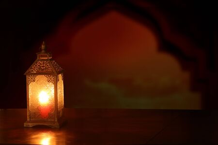 Islamic Greeting Cards for Muslim Holidays. Ramadan Kareem background.Eid Mubarak, greeting background with ñolorful lantern on wooden table Stock Photo