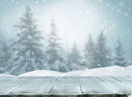 Merry christmas and happy new year greeting background with table .Winter landscape with fir tree
