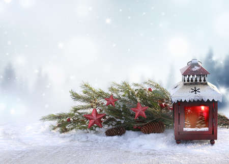 Christmas background with red lantern and fir tree branch. Winter Holidays Scene. New Year greeting card.