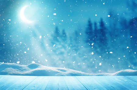 Merry christmas and happy new year greeting background with table .Winter landscape with moon Banco de Imagens
