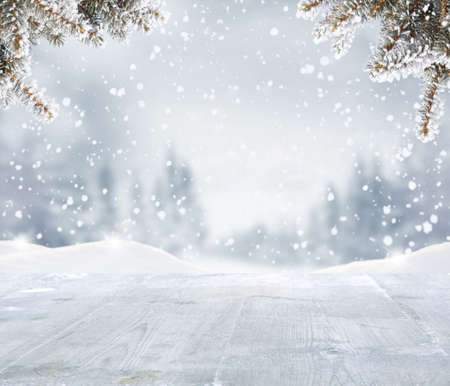 Merry christmas and happy new year greeting background with woden table .Winter landscape with fir tree