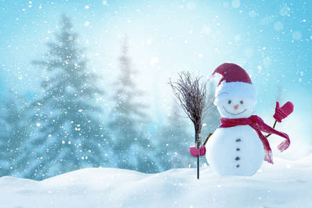 Merry christmas and happy new year greeting card with copy-space.Happy snowman standing in christmas landscape.Snow background.Winter fairytale.