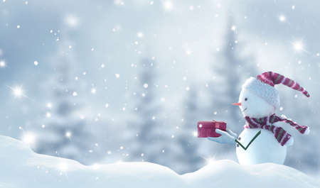 Merry Christmas and happy New Year greeting card with copy-space. Happy snowman standing in Christmas landscape. Snow background. Winter fairytale. Banco de Imagens