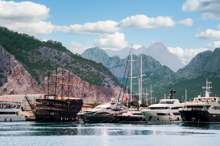 speedboats: Sea harbor with yachts among mountains in Mediterranean